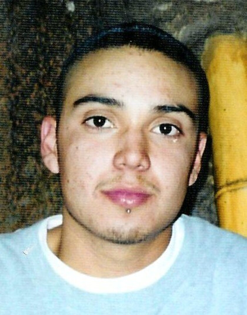 Alexander Ceballos, who was 19, when he was killed in Encanto in 2001. A man has been arrested in the case.