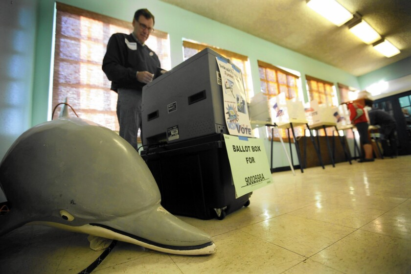 Of California's 17.8 million registered voters, only 42% turned out in November, and that was just 31% of those eligible to vote. Above, election clerk John Schoot waits for voters at a San Pedro polling place.