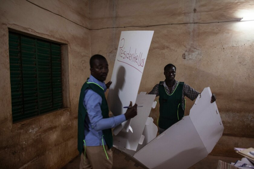 Election officials start clearing a polling station after elections in Ouagadougou, Burkina Faso, Sunday, Nov. 29, 2015. Hundreds of voters lined up after morning prayers to vote Sunday in Burkina Faso's first presidential and legislative elections since a popular uprising toppled the West Africa nation's longtime leader last year.(AP Photo/Theo Renaut)