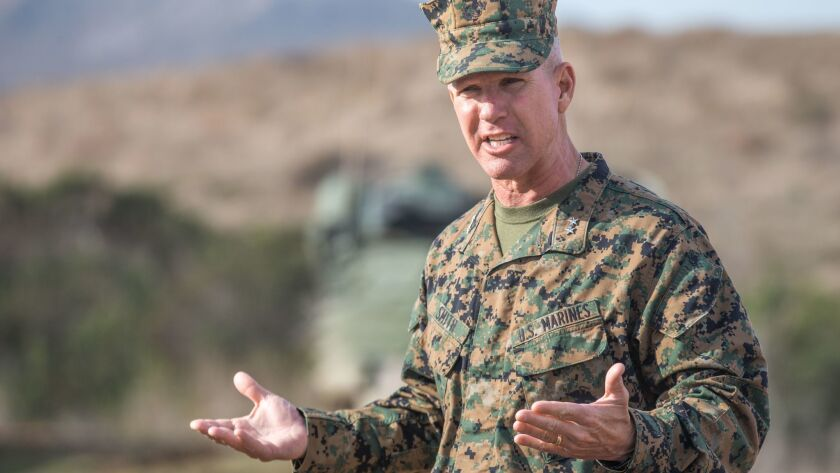 Maj. Gen. Eric Smith, commander of 1st Marine Division, addresses members of The Nice Guys charity during a weapons demonstration at Camp Pendleton on Jan. 16.