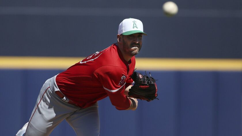 Angels starting pitcher Matt Harvey warms up before a game against the San Diego Padres on March 17.