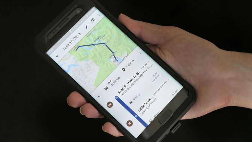 A mobile phone displays a user's travels using Google Maps in New York.