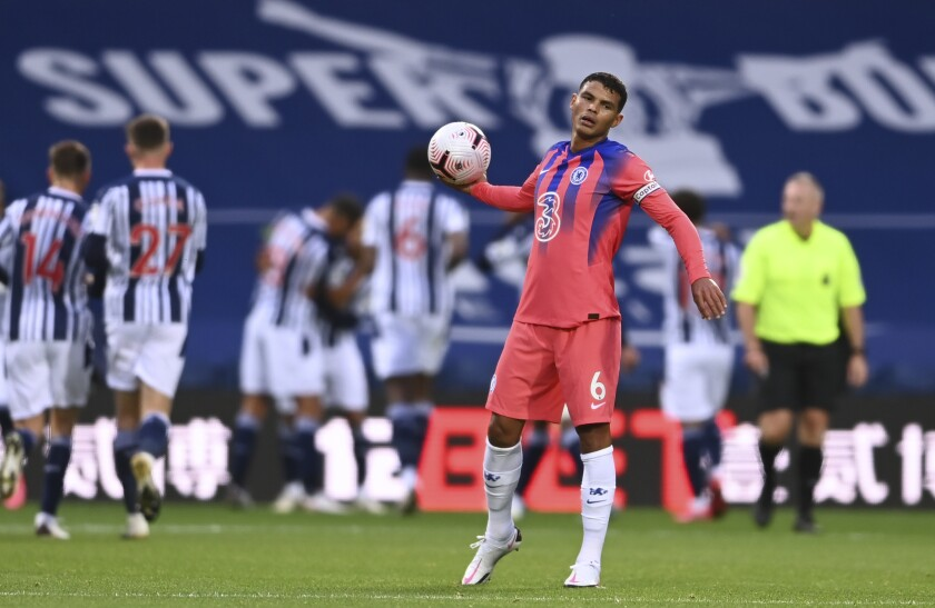 Chelsea's Thiago Silva looks dejected after West Bromwich Albion score their second goal during the English Premier League soccer match between West Bromwich Albion and Chelsea at the Hawthorns in West Bromwich, England, Sunday, Sept. 26, 2020. (Laurence Griffiths/Pool via AP)