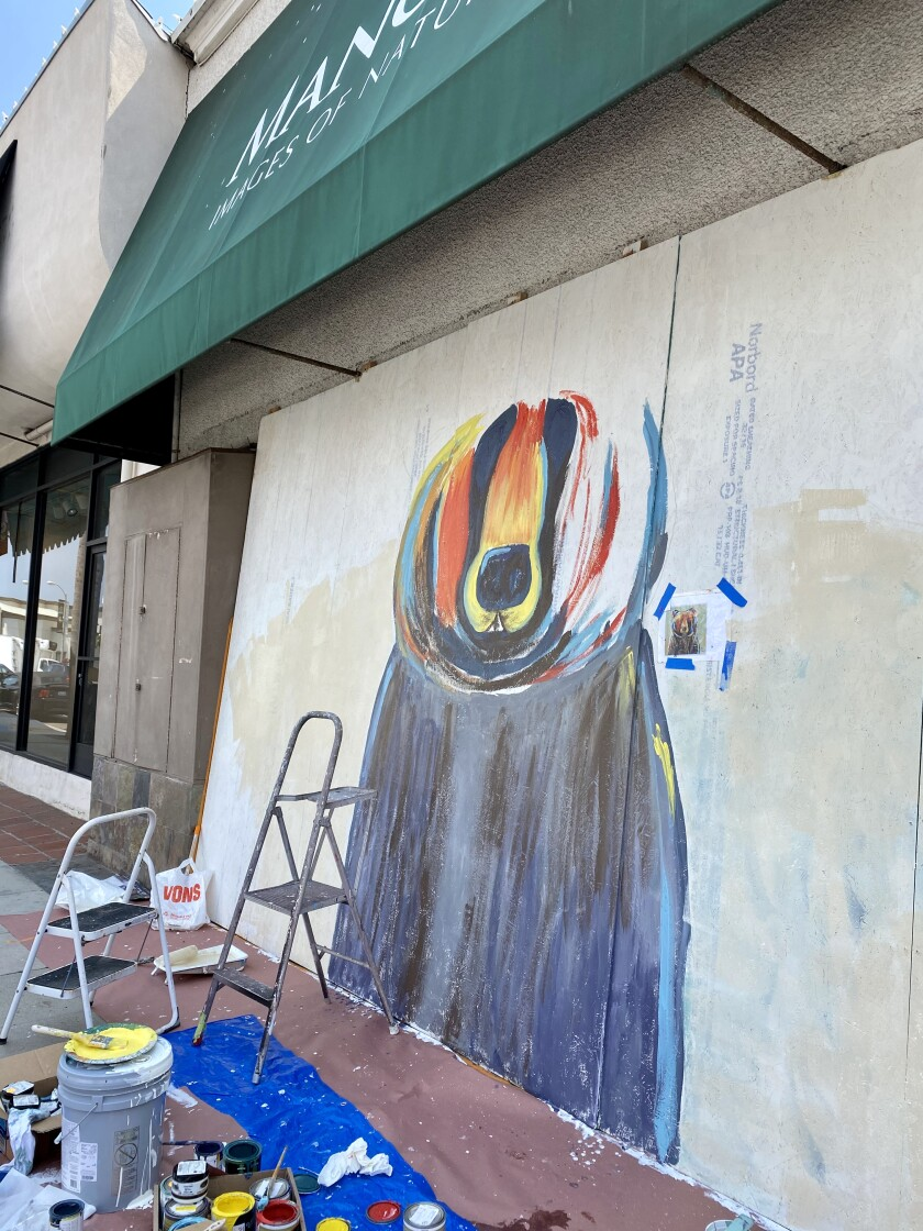 A mural on the Prospect Street side of Mangelsen Images of Nature Gallery is pictured in progress.
