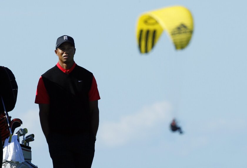 Tiger Woods waits to hit on the  8th hole at Torrey Pines on Monday.