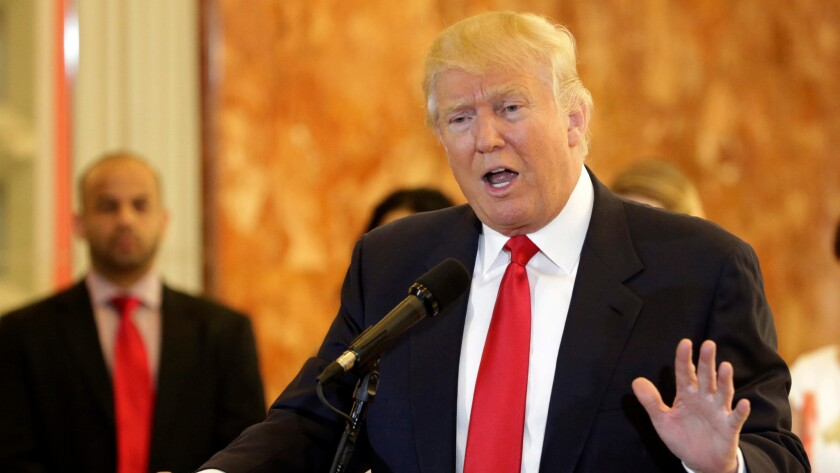 Republican presidential candidate Donald Trump addresses supporters and the media in the lobby of Trump Tower in New York on May 31.