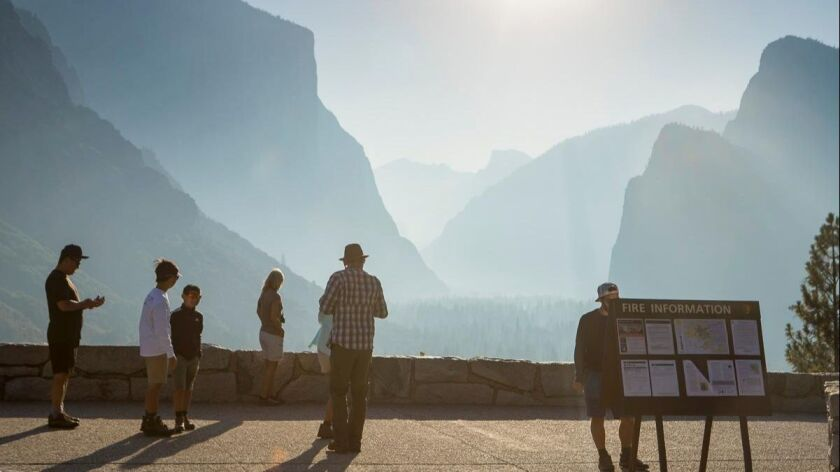 Smoke from the Ferguson fire shrouds Yosemite's landmarks from Tunnel View on Thursday. Only emergency personnel remain in Yosemite Valley during closure of parts of the park.