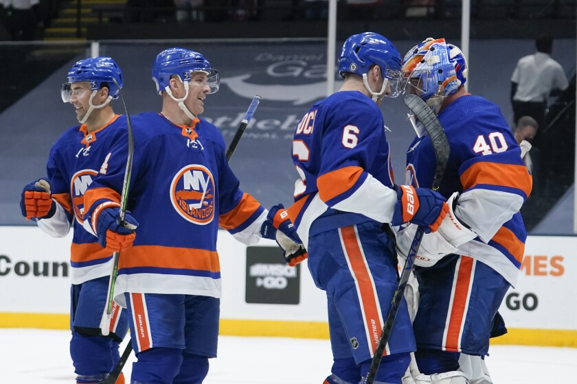 New York Islanders goaltender Semyon Varlamov (40) celebrates with teammates after an NHL hockey game against the New York Rangers, Saturday, May 1, 2021, in Uniondale, N.Y. The Islanders won 3-0. (AP Photo/Frank Franklin II)