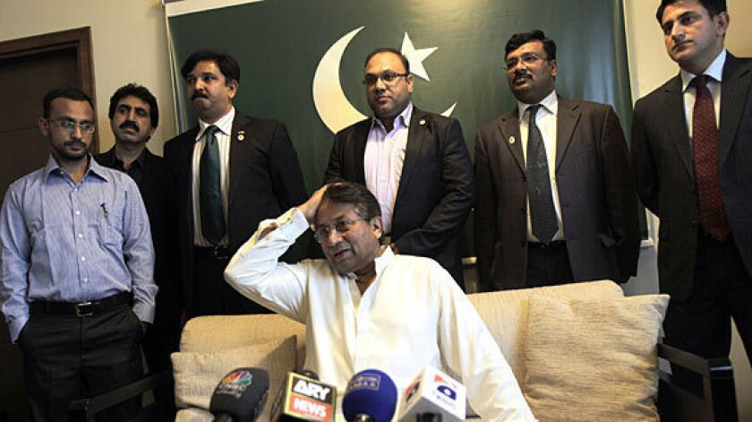 Former Pakistani President Pervez Musharraf talks to journalists in his office in Dubai before leaving for Pakistan.