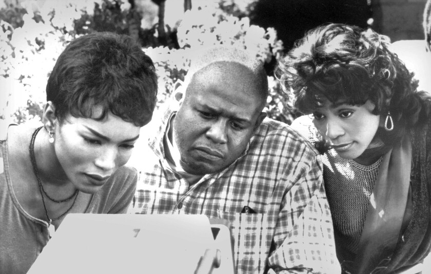 """Angela Bassett, left, director Forest Whitaker and Whitney Houston on the set of """"Waiting to Exhale."""""""