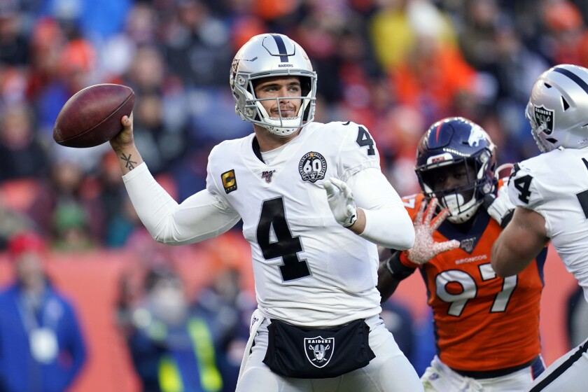 FILE - In this Dec. 29, 2019, file photo, Oakland Raiders quarterback Derek Carr throws a pass during the first half of an NFL football game against the Denver Broncos in Denver. Carr keeps compiling completions and yards at such a fast pace that he already is the career leader for the Raiders in those categories after (AP Photo/Jack Dempsey, File)