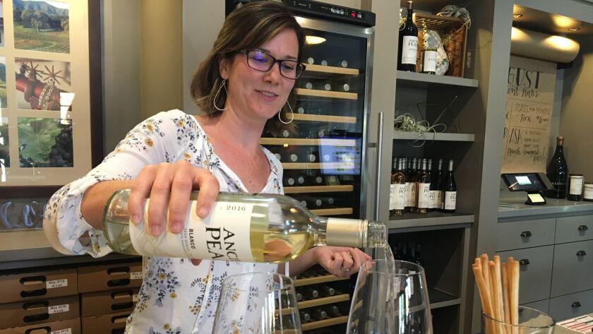 SANTA MARGARITA, CA?AUGUST 2018: Ancient Peaks Winery. Hospitality Manager Alyssa Krichevsky pours 2