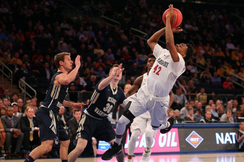 Mar 29, 2016; New York, NY, USA; San Diego State Aztecs guard Jeremy Hemsley (42) shoots the ball while being fouled by George Washington Colonials guard Matt Hart (30) during the first half of a semifinal game of the 2016 NIT basketball tournament at Madison Square Garden. Mandatory Credit: Brad Penner-USA TODAY Sports ** Usable by SD ONLY **