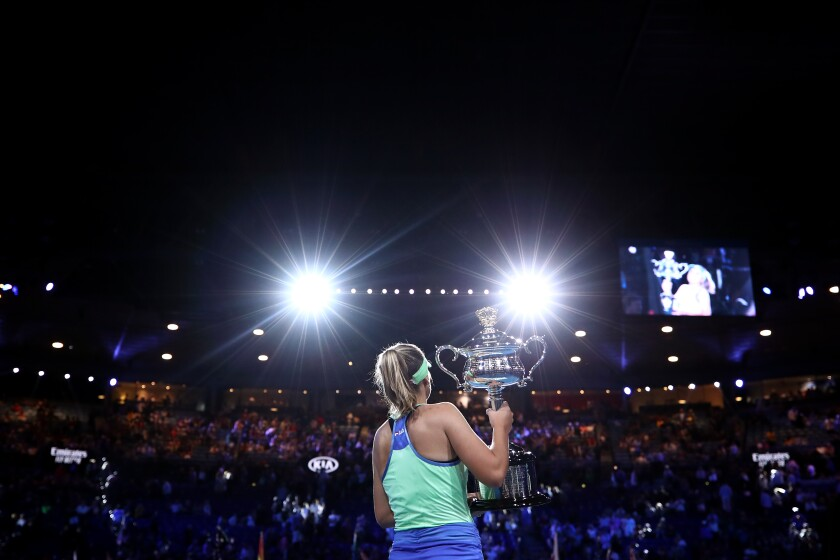 American Sofia Kenin of the United States poses with the Daphne Akhurst Memorial Cup after winning her first career Grand Slam title at the Australian Open.