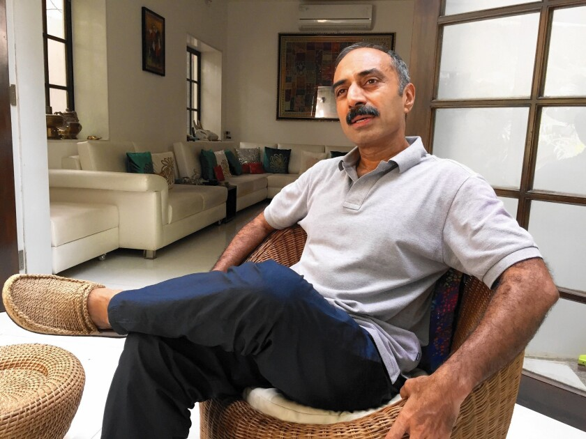 Former police official Sanjiv Bhatt, at home in Ahmedabad, India, says he's being targeted for offering evidence that could damage Prime Minister Narendra Modi in an investigation into deadly 2002 religious riots.