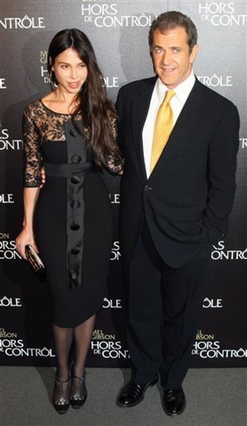 """FILE - In this Feb. 4, 2010 file photo, Mel Gibson and Oksana Grigorieva arrive at the """"Edge Of Darkness"""" Premiere in Paris. (AP Photo/Jacques Brinon, file)"""