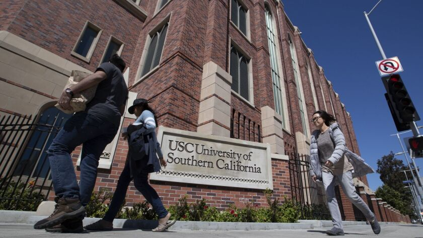 USC officials have placed holds on the accounts of students possibly tied to a far-reaching scandal in which wealthy parents allegedly paid hefty sums to secure admission to schools across the country through bribes and lies.