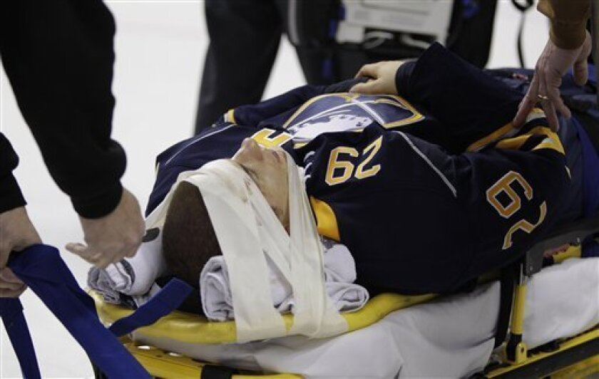 Buffalo Sabres' Jason Pominville (29) is carted off the ice after a hit during the first period of an NHL hockey game against the Chicago Blackhawks in Buffalo, N.Y., Monday, Oct. 11, 2010. (AP Photo/ David Duprey)