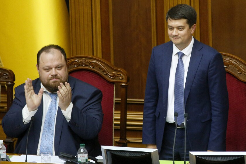 FILE- In this Aug. 29, 2019 photo, newly elected parliament speaker Dmytro Razumkov, right, and first vice speaker Ruslan Stefanchuk attend a parliament session in Kyiv, Ukraine. Ukrainian lawmakers have voted to dismiss Razumkov, a move that comes as part of infighting in the ruling party. Razumkov was stripped of his duties Thursday, Oct. 7, 2021 by the Verkhovna Rada after President Volodymyr Zelenskyy's Servant of the People party initiated his dismissal. (AP Photo/Efrem Lukatsky, file)