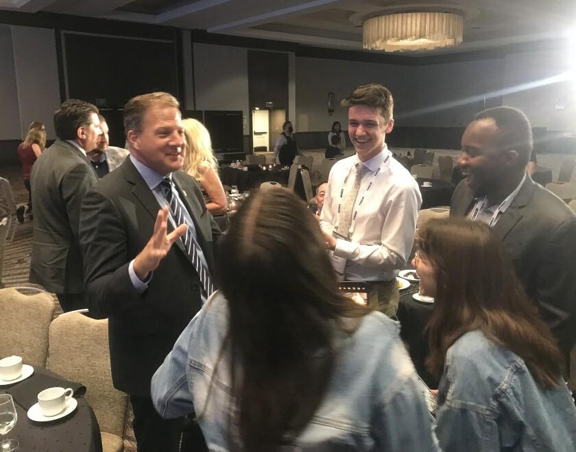 New Hampshire Governor Chris Sununu talks to GOP delegates