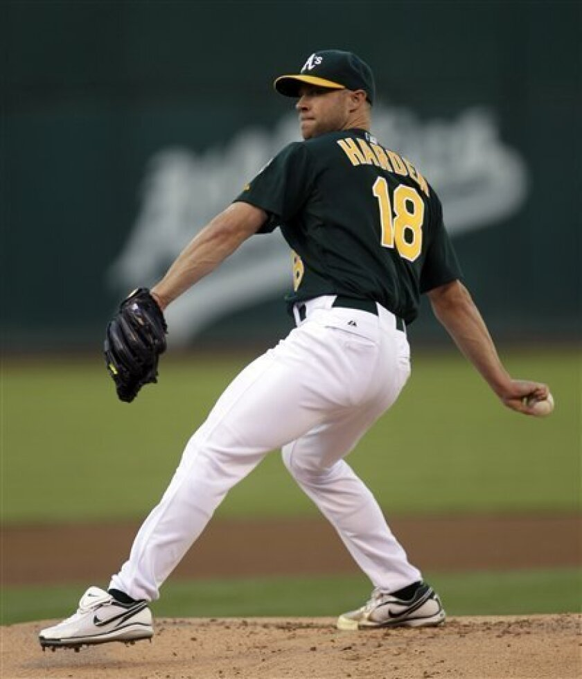 Oakland Athletics' Rich Harden works against the during the Arizona Diamondbacks during the first inning of an interleague baseball game on Friday, July 1, 2011, in Oakland, Calif. (AP Photo/Ben Margot)