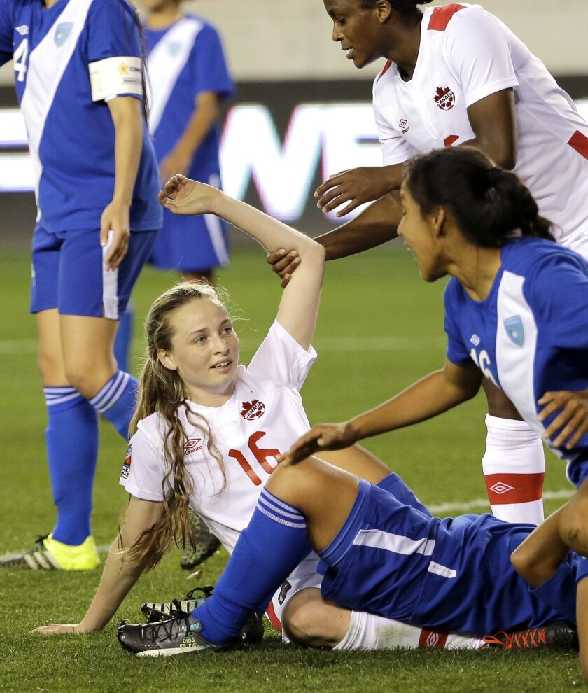 Canada's Gabrielle Carle (16) celebrates after scoring a goal against Guatemala during the first half of a CONCACAF Olympic qualifying tournament soccer match Tuesday, Feb. 16, 2016, in Houston. (AP Photo/David J. Phillip)