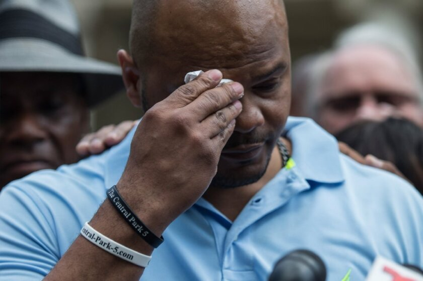 Kevin Richardson wipes away tears as he discusses a settlement he and four other men reached with New York City over their wrongful convictions in the 1989 Central Park Jogger case.