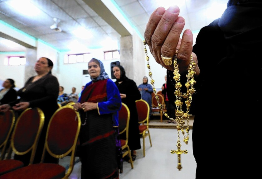 Displaced Christians who fled Mosul pray at a church in the town of Qaraqosh, Iraq. In Mosul, Islamic State militants reportedly gave Christians a deadline to convert to Islam, leave the city or face death.