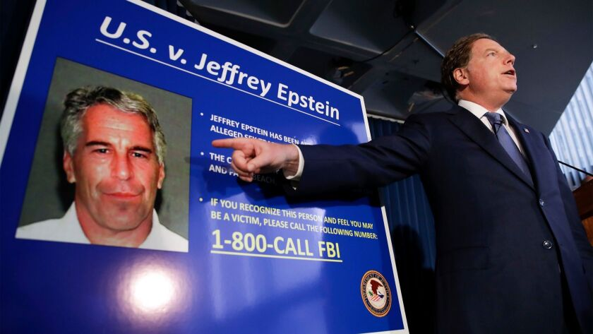 Geoffrey Berman displaying a poster of Jeffrey Epstein.