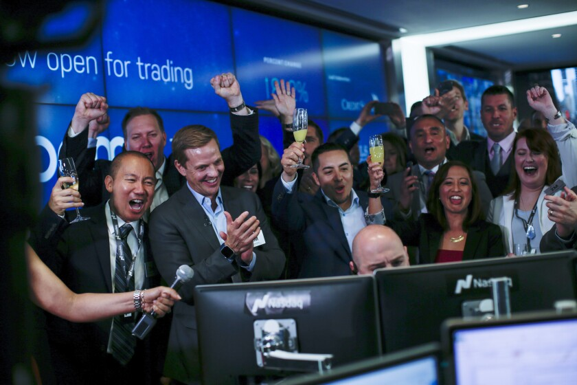 Employees react as public stock trading on Zoom Video Communications Inc. begins on April 18, 2019.