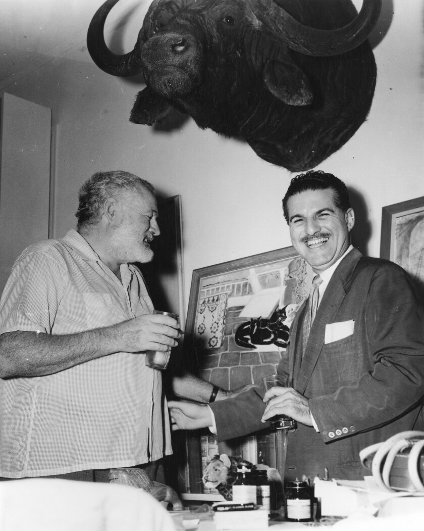 (L-R)- Ernest Hemingway laughs with Cuban journalist Fernando Campoamor at Finca Vigia near San Fran