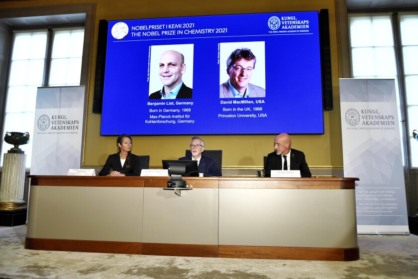 Goran Hansson of the Royal Swedish Academy of Sciences (center) announces the winners of the 2021 Nobel Prize in chemistry.