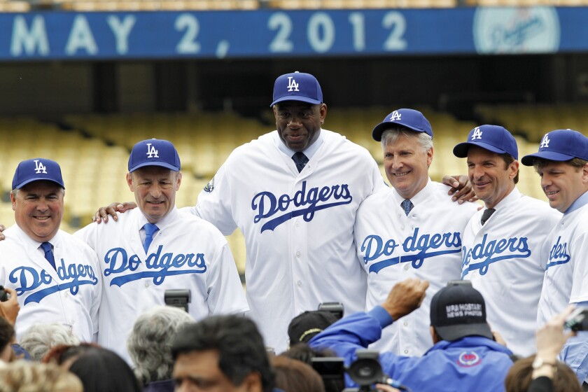 "Guggenheim Baseball Management leaders — including, from left, Bobby Patton, Stan Kasten, Magic Johnson, Mark Walter, Peter Gruber and Todd Boehly — vowed in 2012 to build ""something long-term, and sustainable."""