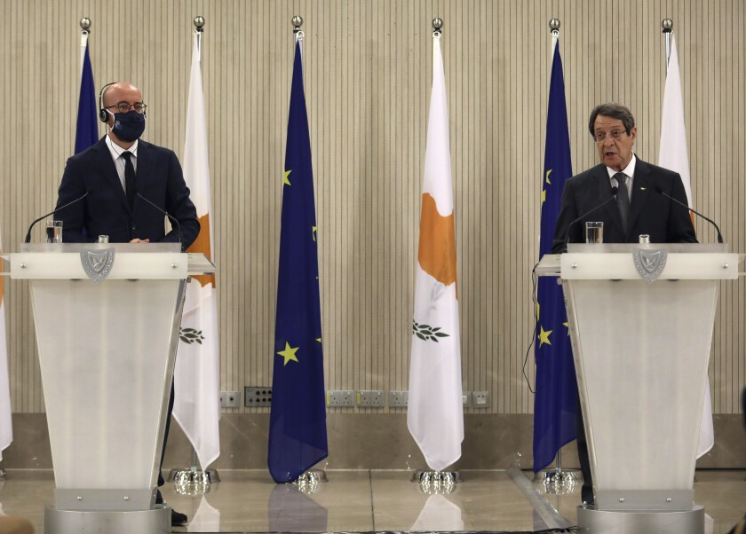 European Union Council President Charles Michel, left and and Cyprus' President Nicos Anastasiades talk to the media during a press conference, at the Presidential Palace in the capital Nicosia, Cyprus, Wednesday, Sept.16, 2020. Michel is visiting Cyprus after traveling to Greece amid a diplomatic drive to de-escalate a weeks-long standoff at sea over Turkey's hydrocarbons search in waters were Greece and Cyprus claim exclusive economic rights. (Yiannis Kourtoglou, Pool via AP)