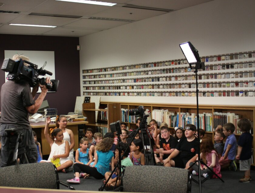 NBC crews for 'The Today Show' film children during a reading of 'What Pet Should I Get?' at UC San Diego's Geisel Library July 23.