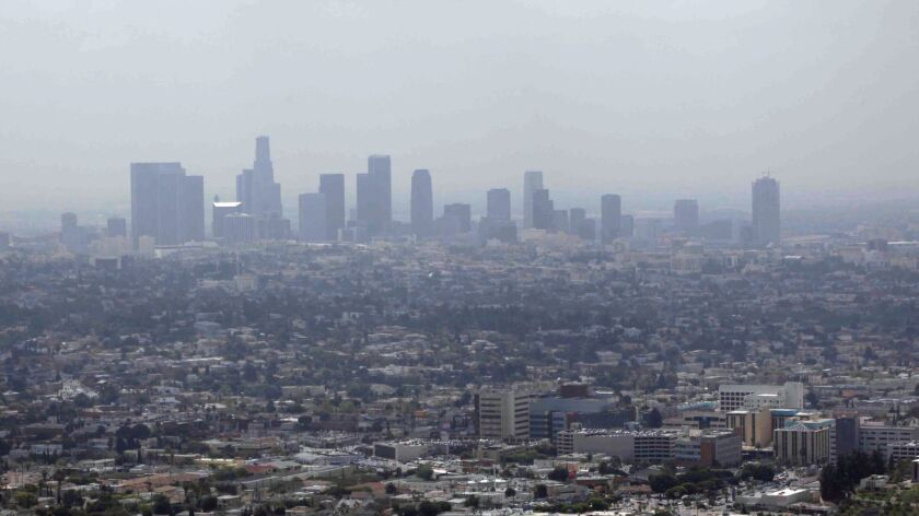 FILE - In this April 28, 2009 file photo, smog covers downtown Los Angeles. Attorney General Xavier
