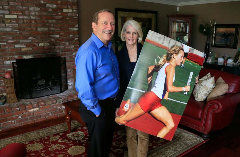 Greg and Missy Post of Encinitas host the second annual Amanda Post Track Meet in Carlsbad on June 4. The track meet, which is named after their late daughter, is designed to inspire grade-schoolers to run track. Amanda Post, a CIF gold medalist in track, was killed in a multi-vehicle crash near Bishop in 2010. She was 18. — Misael Virgen