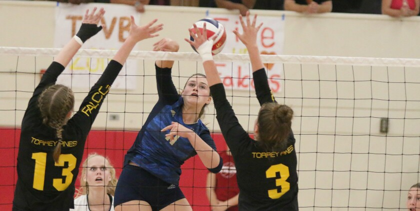 LCC middle blocker Taylor Putnam looks for a hole in the Torrey Pines block.