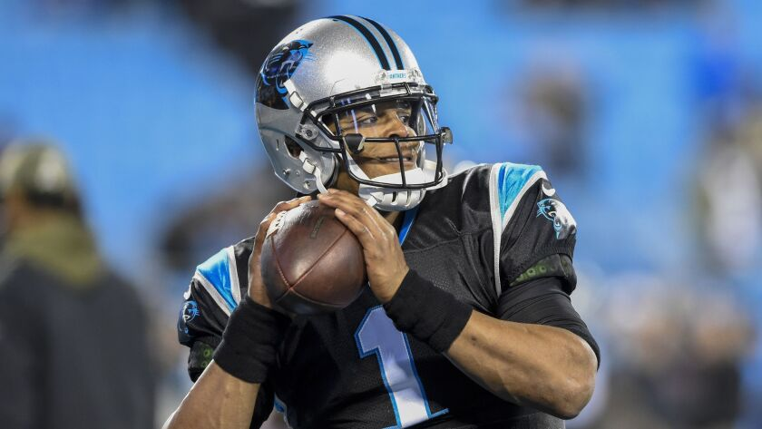 Panthers quarterback Cam Newton makes a pass against the Saints on Dec. 17.