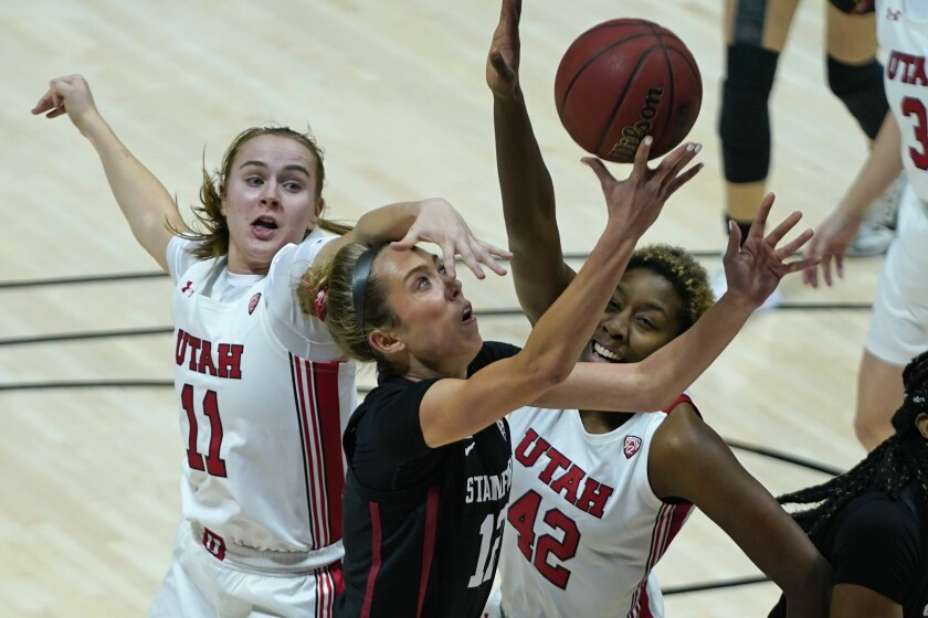 Utah's Brynna Maxwell (11) and Peyton McFarland (42) defend against Stanford guard Lexie Hull (12) in the first half during an NCAA college basketball game Friday, Jan. 15, 2021, in Salt Lake City. (AP Photo/Rick Bowmer)
