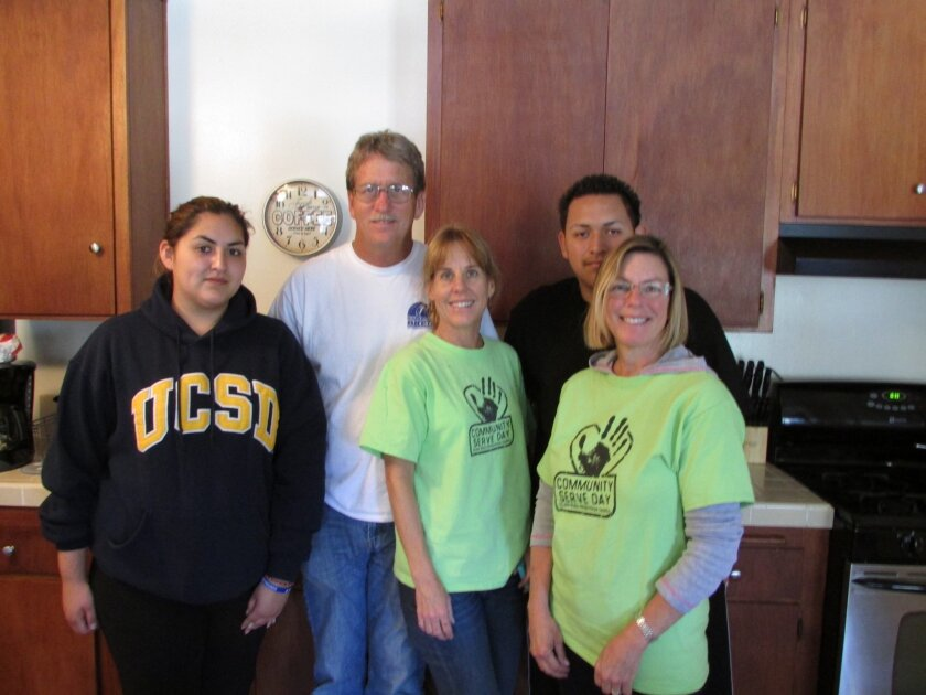 Gretchen Morgan (middle) with other volunteers and Just in Time youth family members.