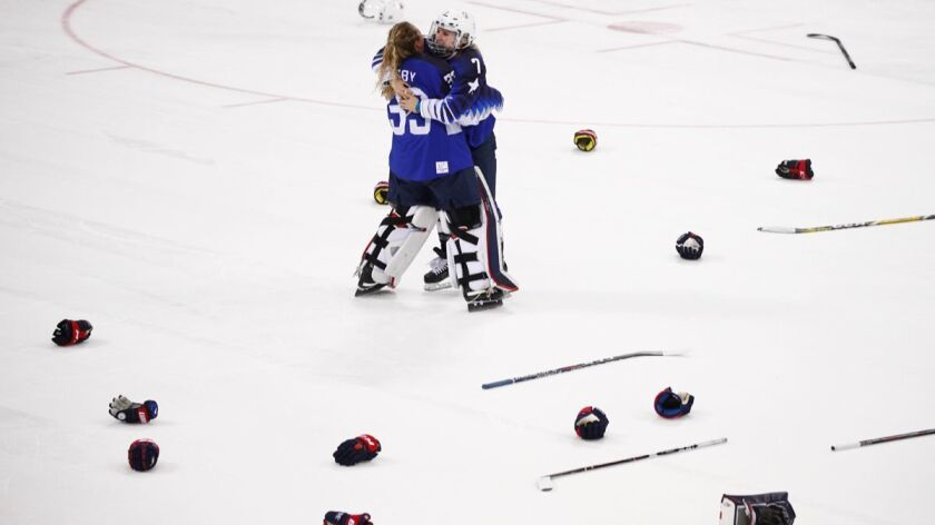 Alex Rigsby and Monique Lamoureux-Morando, right, celebrate after winning the women's gold medal game against Canada at the 2018 Winter Olympics.
