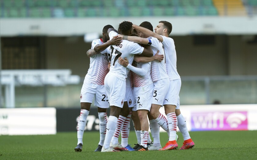 AC Milan players celebrate after their teammate Rade Krunic scored the opening goal during a Serie A soccer match between Hellas Verona and AC Milan, at the Bentegodi Stadium in Verona, Italy, Sunday, March 7, 2021. (Spada/LaPresse via AP)
