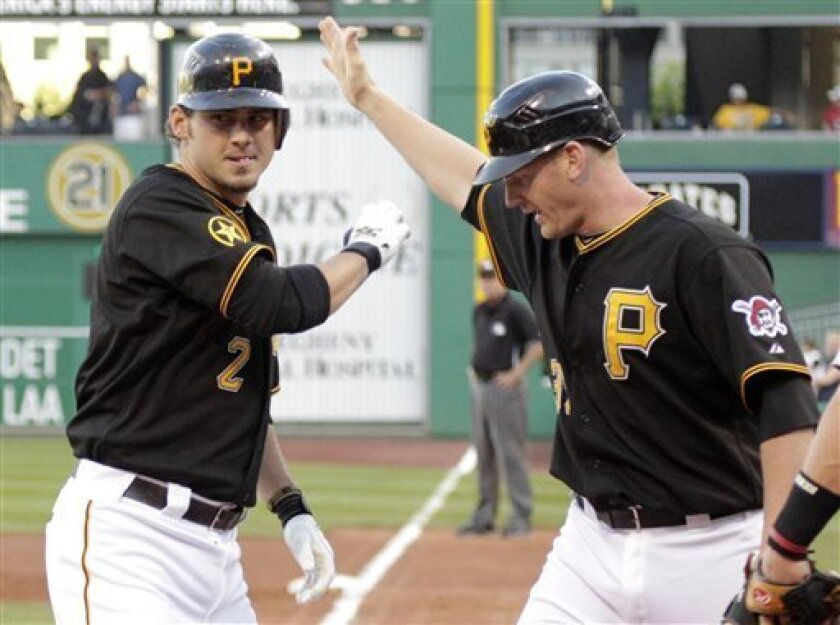 Pittsburgh Pirates' Brandon Wood, left, is greeted by Lyle Overbay after hitting a two-run homer off Houston Astros pitcher Wandy Rodriguez in the second inning of a baseball game in Pittsburgh Tuesday, July 5, 2011. (AP Photo/Gene J. Puskar)