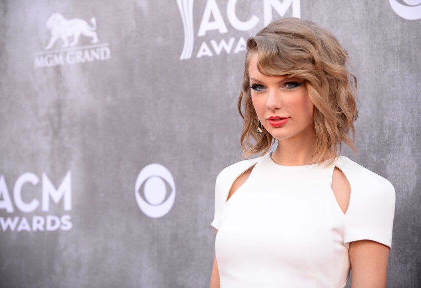 Taylor Swift arrives at the 49th annual Academy of Country Music Awards at the MGM Grand Garden Arena in Las Vegas.