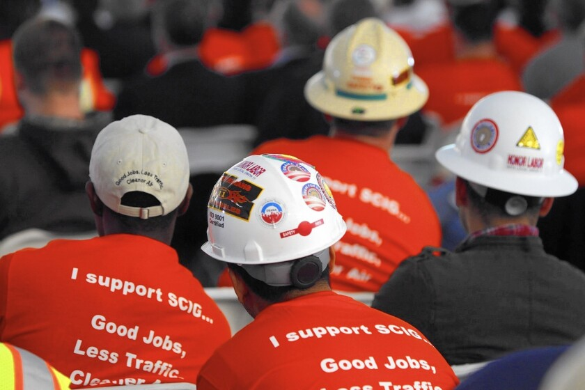Union members turn out to support rail project