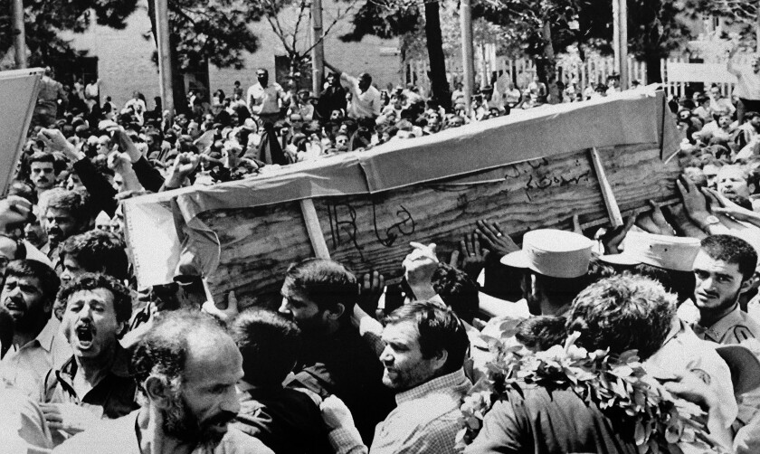 "The casket of one of the people killed when the U.S. shot down an Iranian jetliner is carried through the streets of Tehran by Iranians shouting, ""Death to America,"" on July 7, 1988."