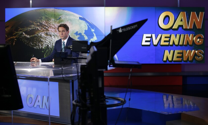 Patrick Hussion waits for a break while hosting an evening news segment at San Diego based One America News on Sept. 5, 2019.