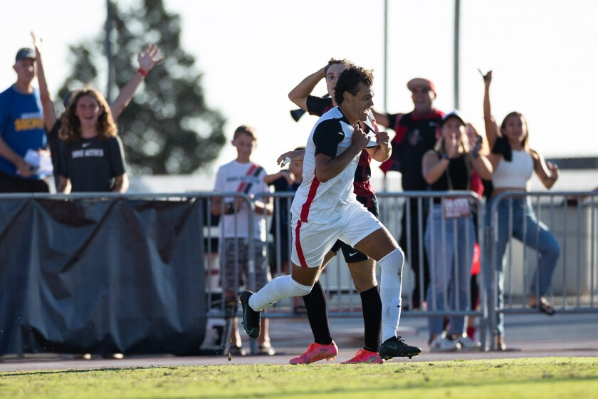 SDSU senior forward Tevenn Roux celebrates after scoring the winning goal in overtime for a 1-0 victory against Stanford.