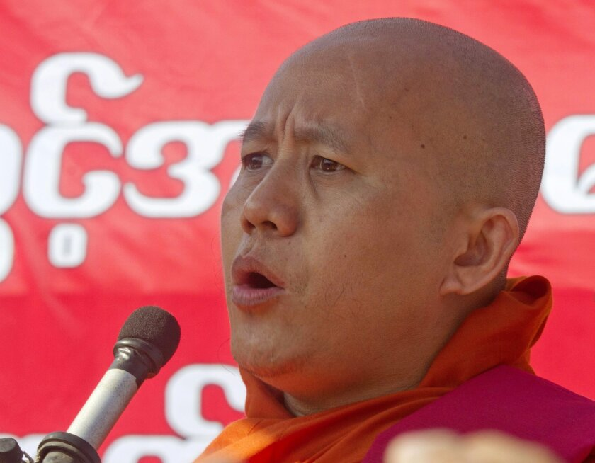 FILE - In this Jan. 16, 2015 file photo, nationalist Buddhist monk Wirathu speaks during a rally to protest against a resolution adopted by the U.N. General Assembly calling on Myanmar to grant citizenship to Rohingya, in Yangon, Myanmar. Myanmar's government has denounced an influential Buddhist n